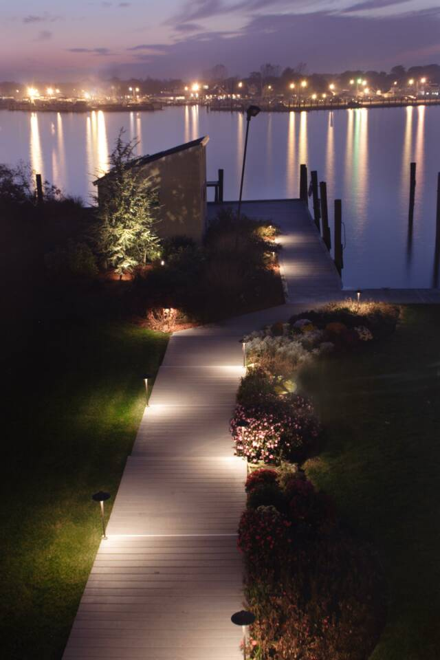 CAST Landscape Lighting. View of dock and landscaping nicely lit.
