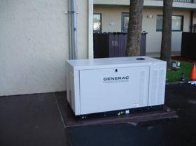 Generator Installation. GENERAC generator installed outside of building.